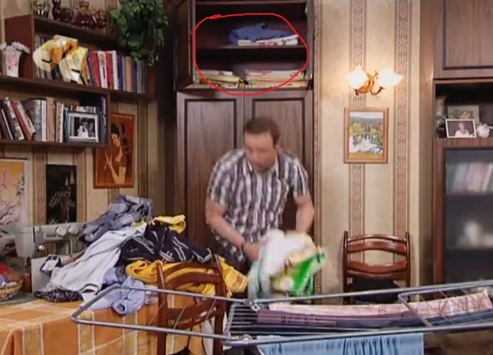 Костя достаёт вещи из шкафа
